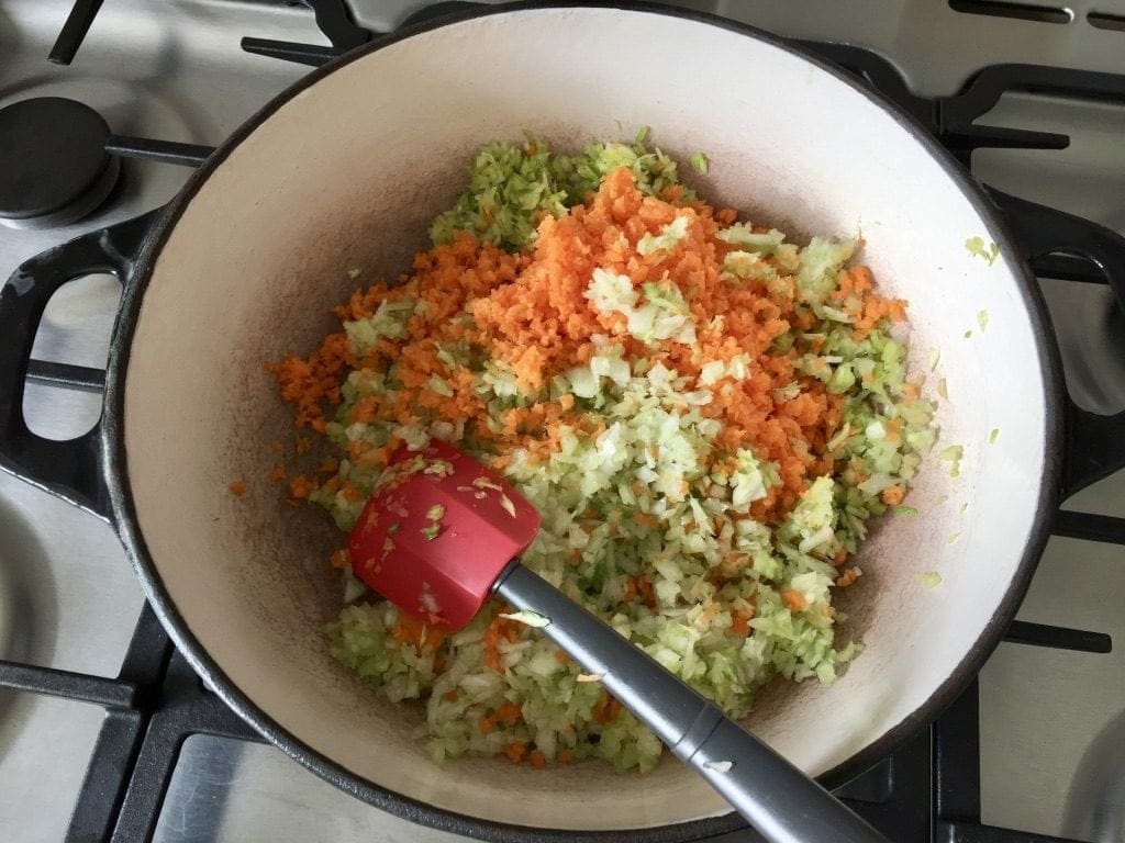Veggie mixture sautéing in a pan.
