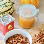 Roasted pumpkin seeds, pumpkin puree in a jar & paprika.