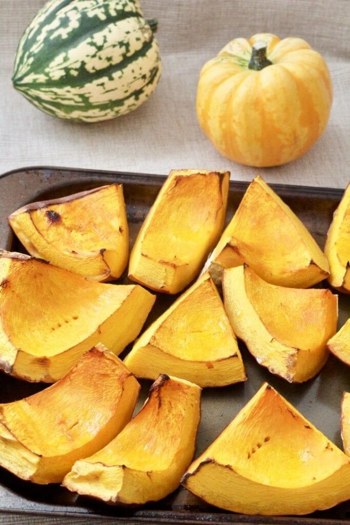 Pumpkin chunks on baking tray after roasting.