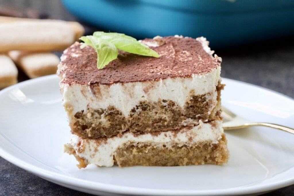 Easy Eggless Tiramisu - close up of Tiramisu portion on a plate
