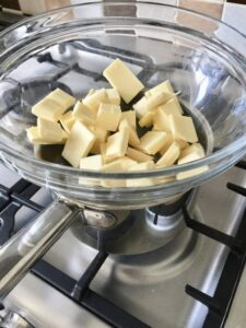 White Chocolate Blondies with Mini Eggs - butter & chocolate being melted in brine Marie