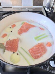 Fish and veg poaching in milk.