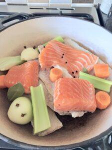 Fish & veg in a casserole dish.