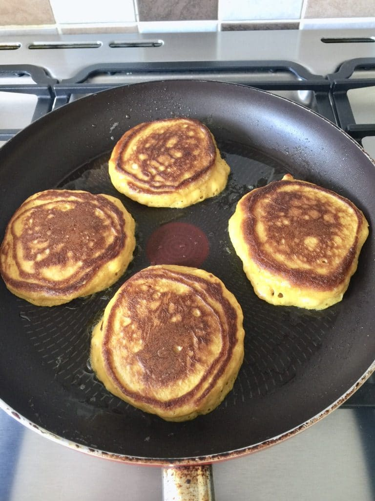 4 pancakes frying on the other side.