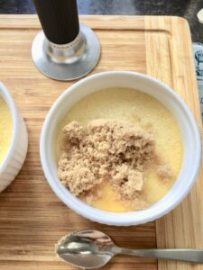 Vanilla Crème Brûlée - sugar sprinkled over cooked and chilled custard