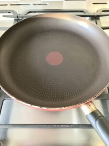 Frying pan on the hob ready to fry pancakes.
