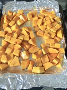 Easy Butternut Squash & Chorizo Gnocchi - chunks of butternut squash on the baking tray ready for roasting