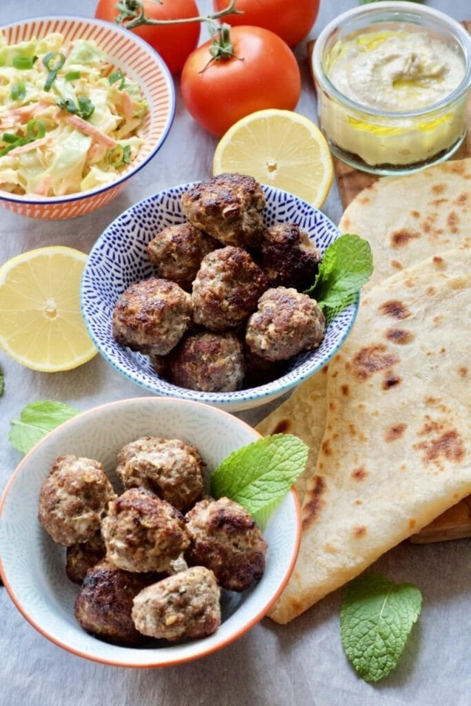 Easy Lamb Kofta Meatballs in bowls with accompaniments