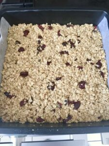 Flapjacks with cranberries in a baking tin