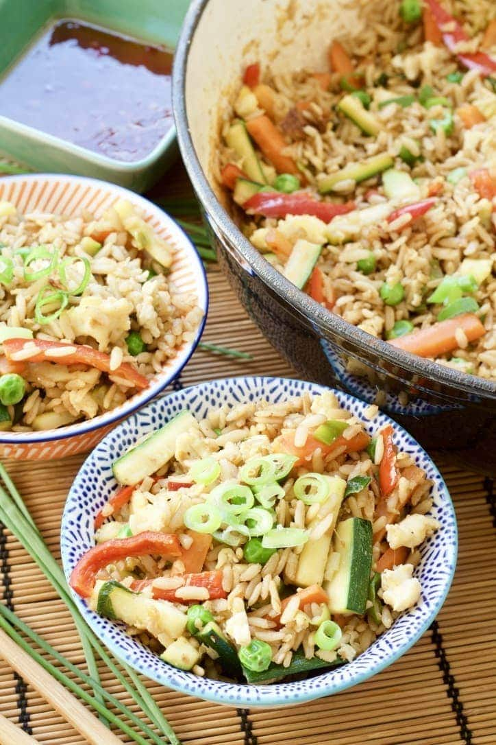 Vegetable Egg Fried Rice in bowls and in a pan