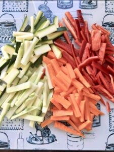 variety of veggies cut up into matchsticks