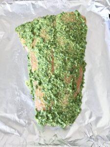 Salmon side covered in pesto
