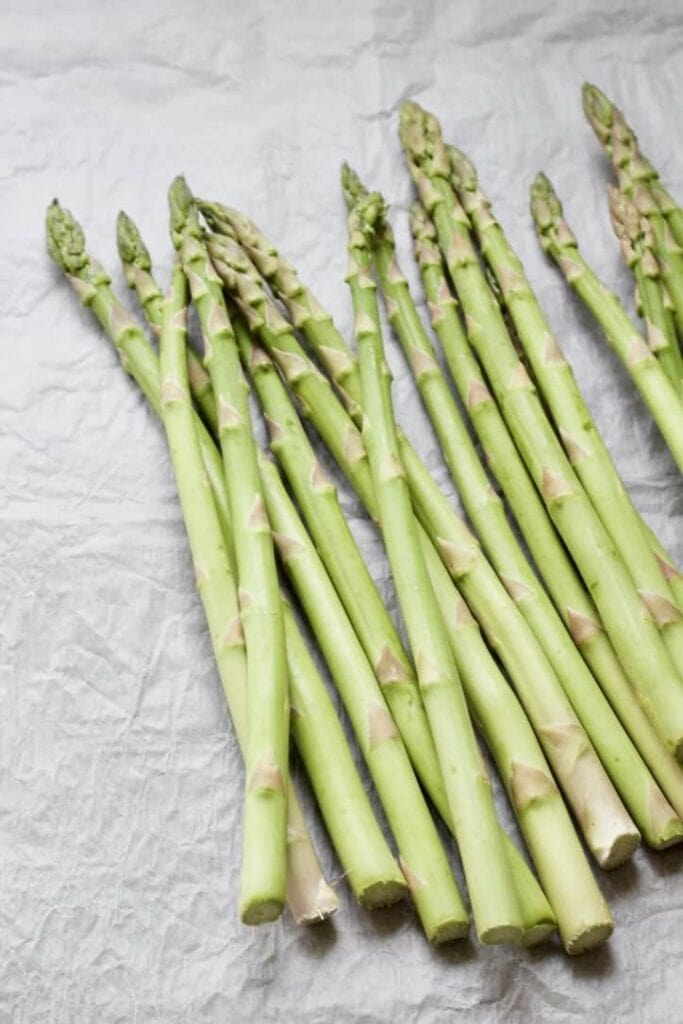 asparagus spears on a parchment