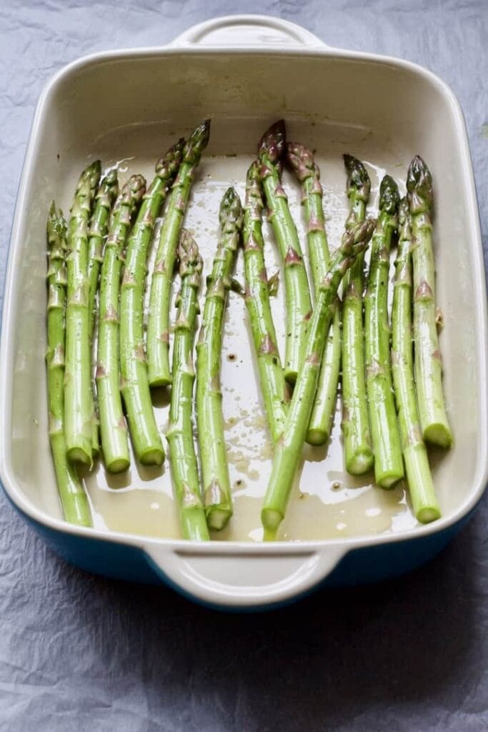 asparagus spears in a roasting dish