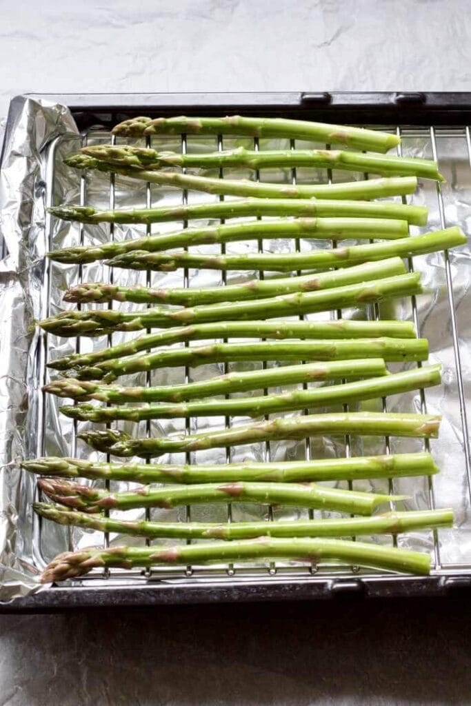asparagus spears on a roasting rack