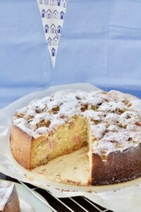 Rhubarb cake on a cooling rack.