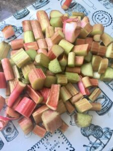 Chunks of rhubarb on a chopping board.