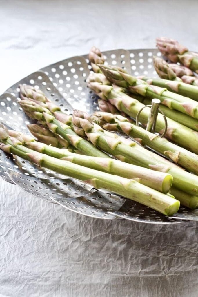 Asparagus in a steaming basket.