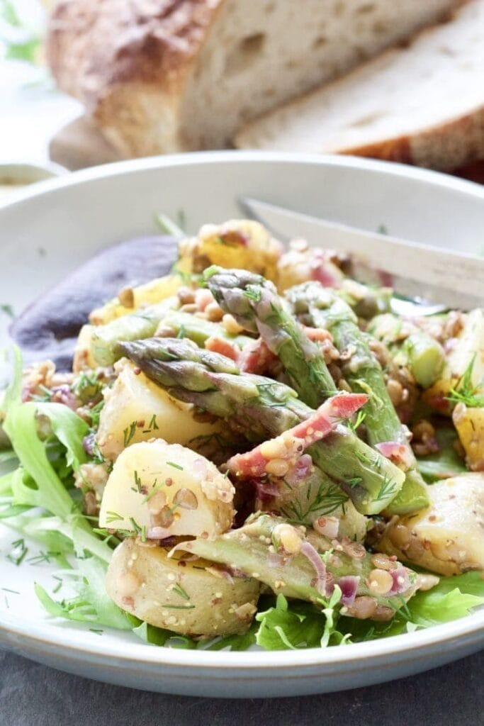 Potato asparagus salad on a plate close up.