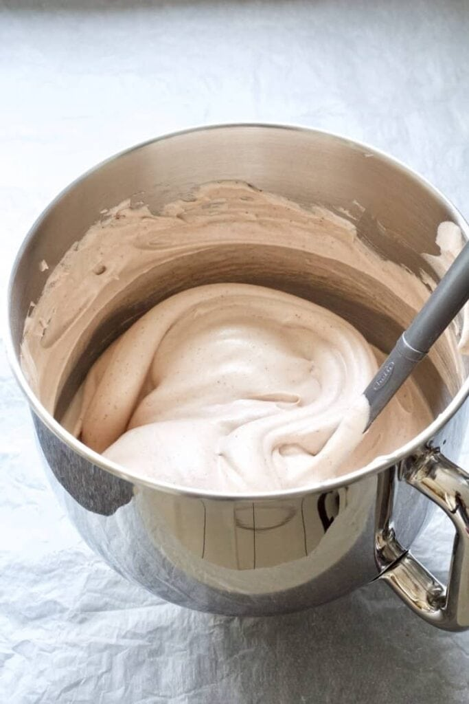 Ready chocolate pavlova mixture in a bowl.