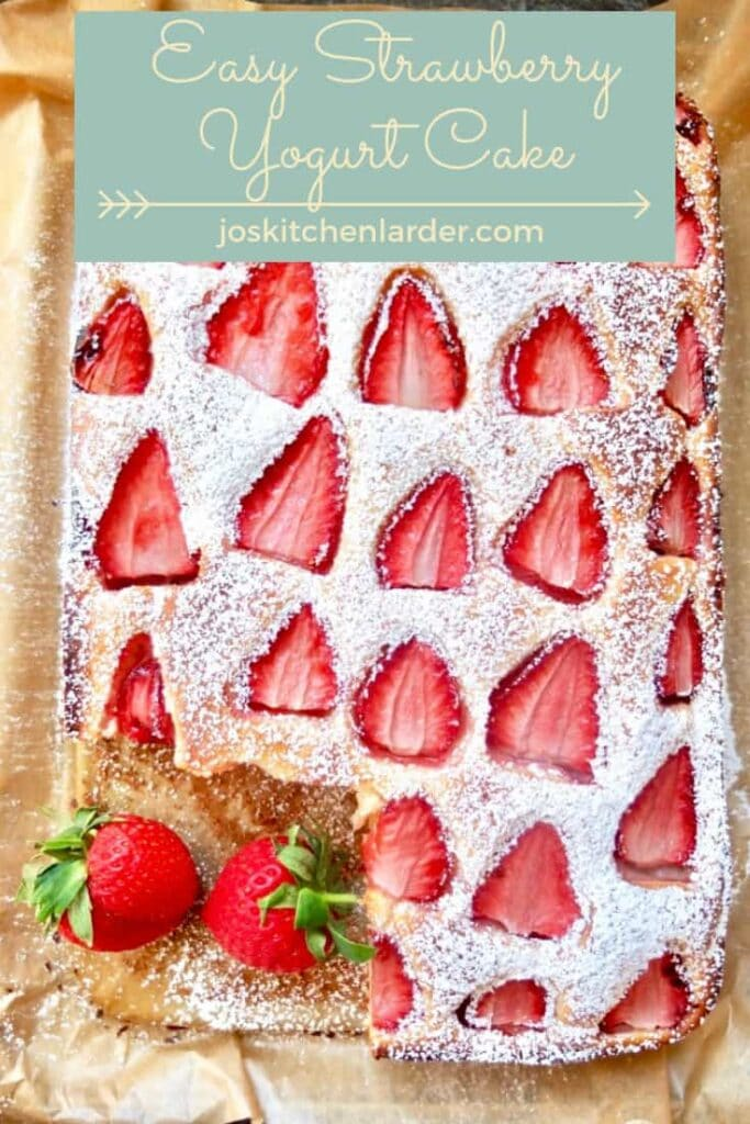 Strawberry cake with one slice missing.