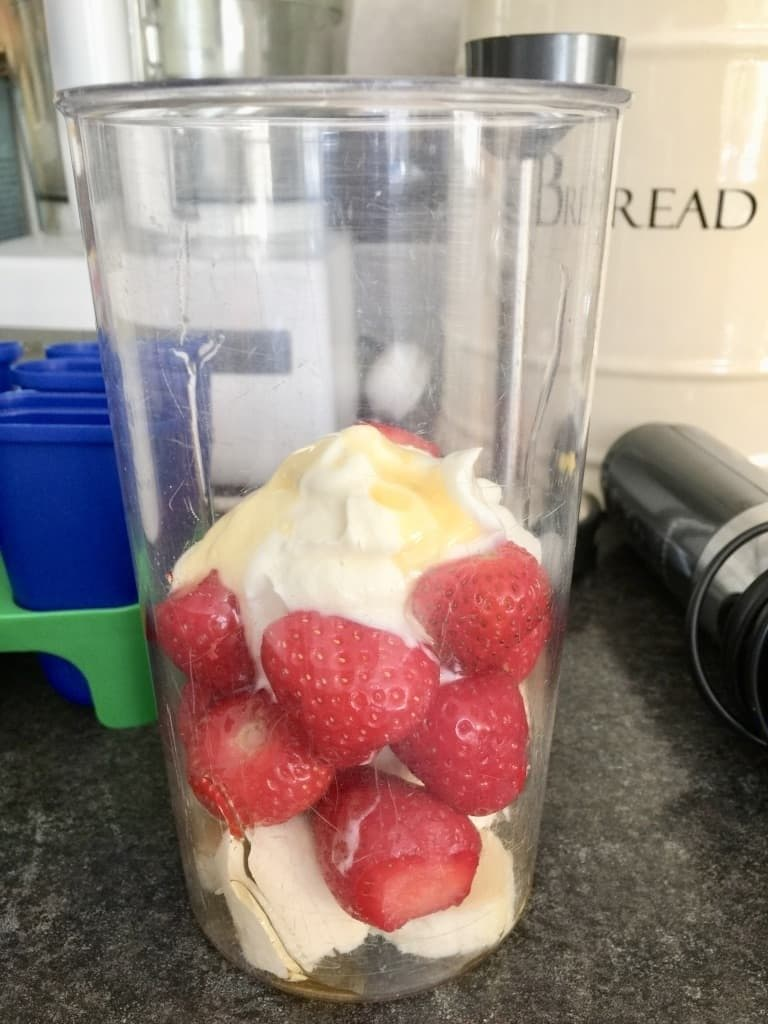 Strawberries, banana, yogurt & honey in a blender.