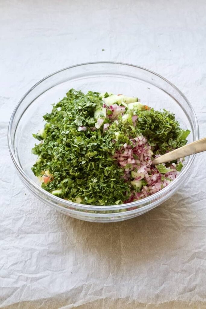 Tabbouleh salad ingredients in a bowl.