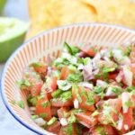 Fresh tomato salsa in a small bowl.
