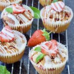 Strawberry muffins on a cooling rack.