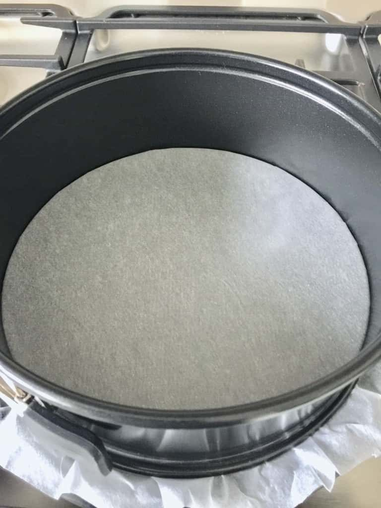 Round cake tin lined with baking paper.