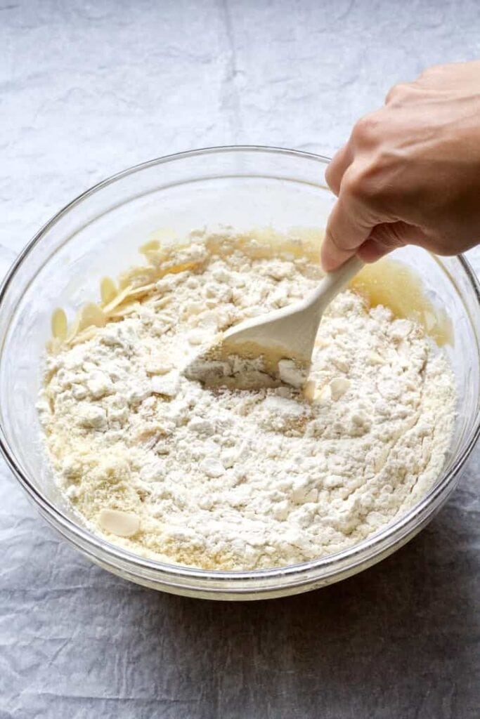 Dry ingredients being mixed into the batter.
