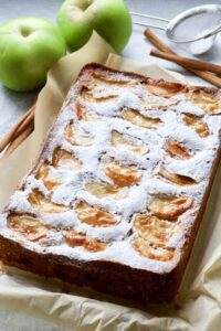 Dorset apple cake with icing sugar out of the tin.