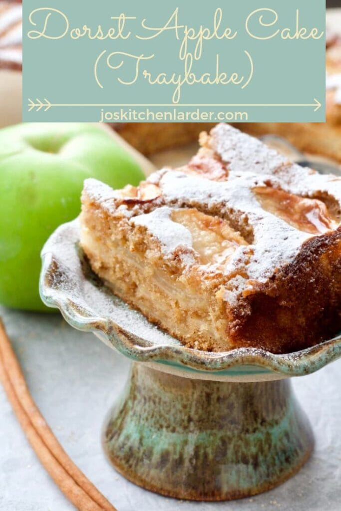 Slice of Dorset apple cake on a mini stand.