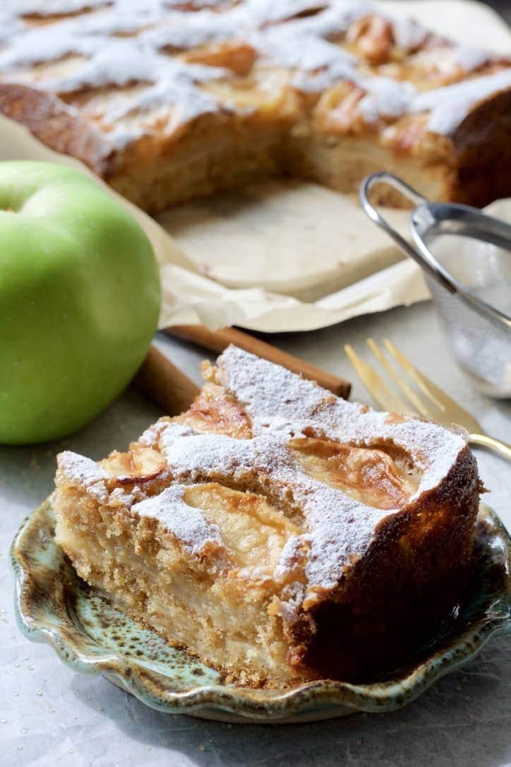 Slice of Dorset apple cake on a plate.