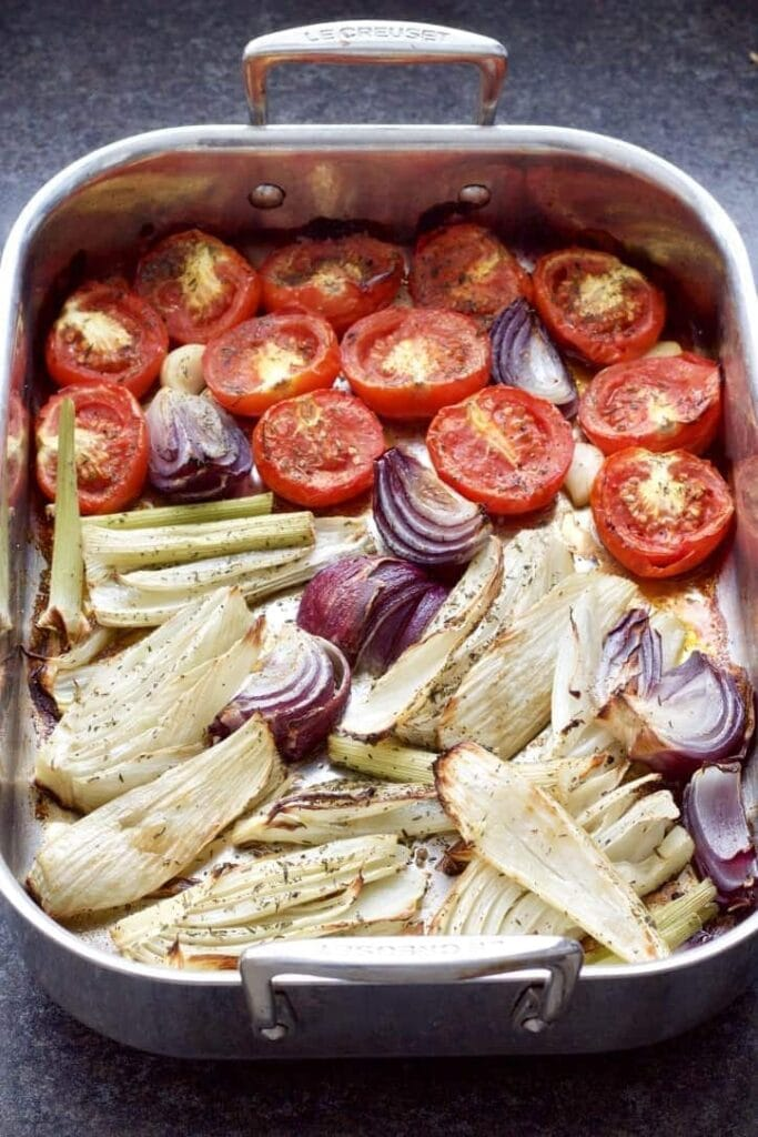 Roasted tomatoes, fennel, onion in a roasting tin.