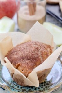 Apple & cinnamon muffin wrapped in paper.
