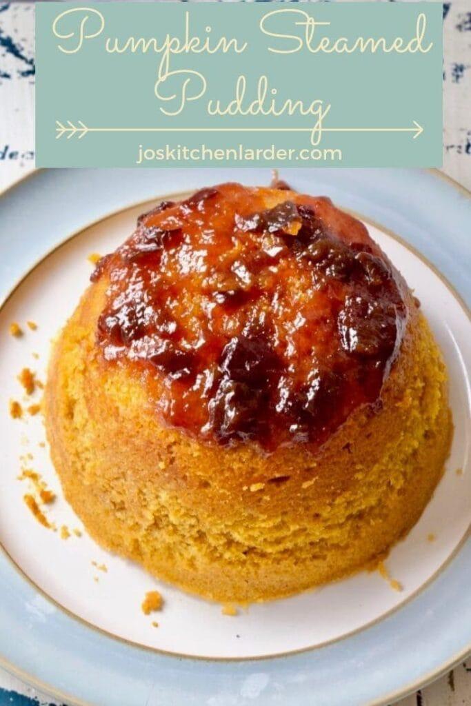 Whole pumpkin steamed sponge pudding on a plate.
