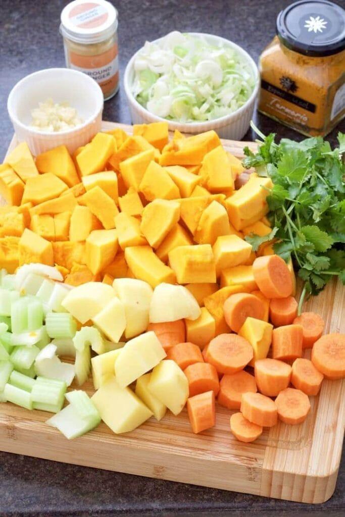 Chopped ingredients to make pumpkin soup.