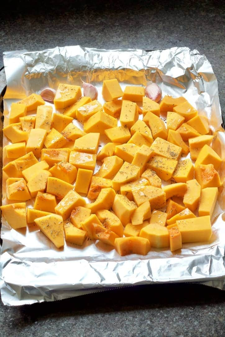 Chunks of butternut squash on a baking tray.