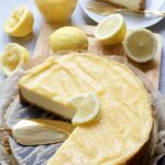 Cheesecake topped with lemon curd and lemon slices.
