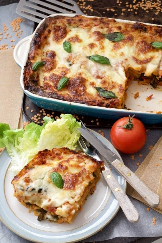 Plated up portion & dish of baked lasagne.