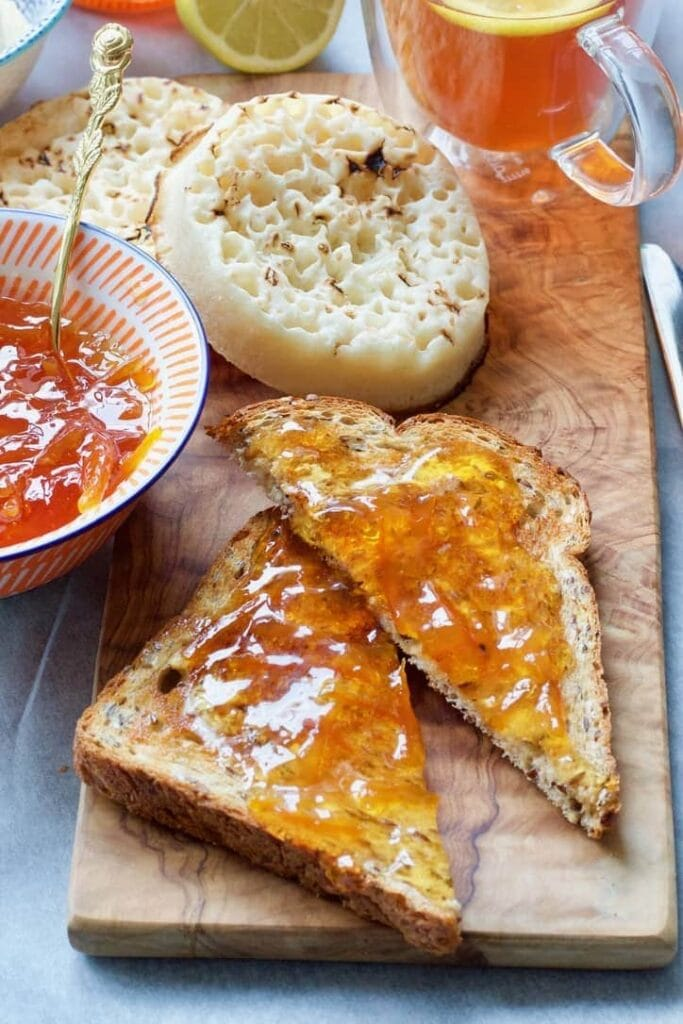 Two pieces of toast with marmalade.