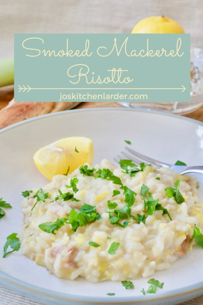 Portion of risotto in a bowl with lemon wedge.