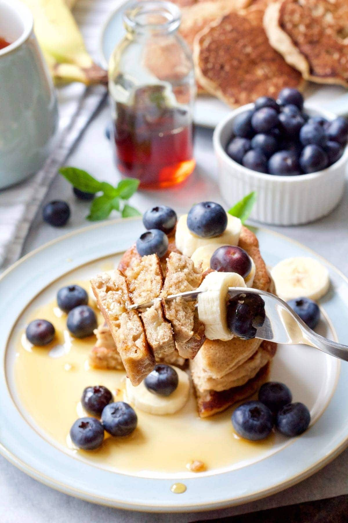 Forkful of pancakes, banana slice & blueberry.