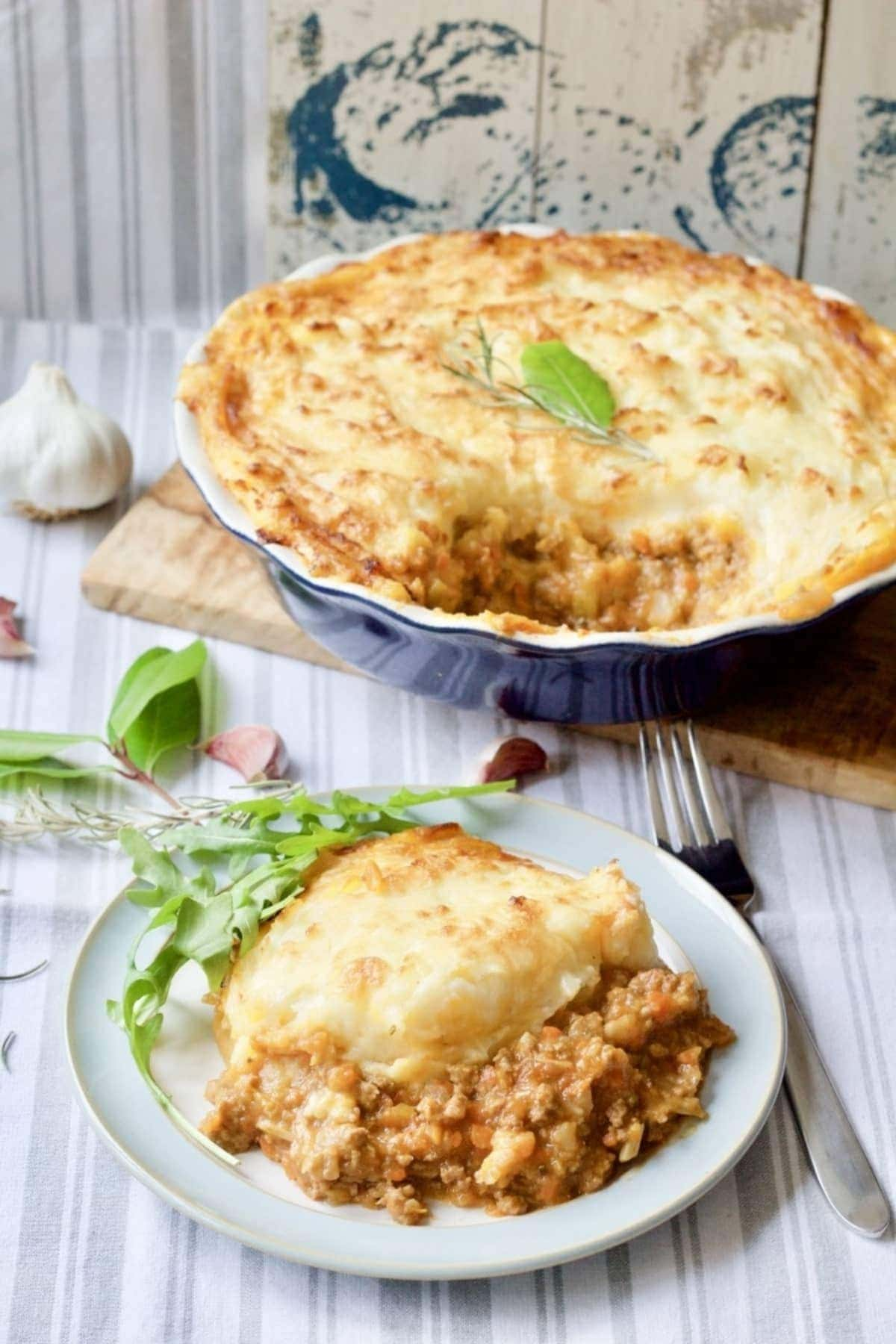 Shepherd's pie in a dish and portion on a plate.