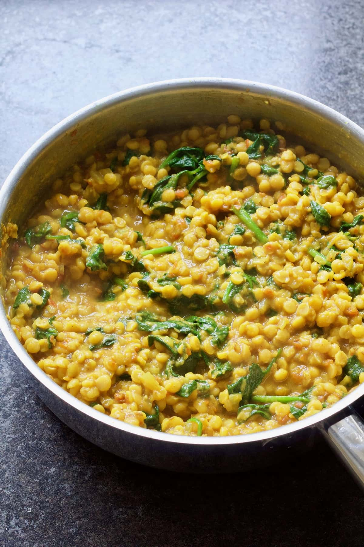 Finished dhal with wilted spinach.
