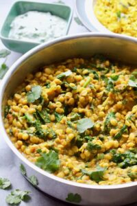 Tarka Dhal garnished with coriander in a pan.