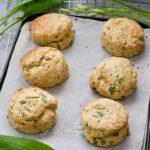 6 baked vegan cheese scones on baking tray.