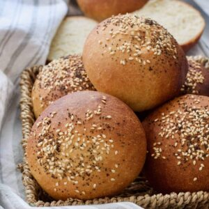 Bread rolls in the basket with sesame & poppy seeds on top.