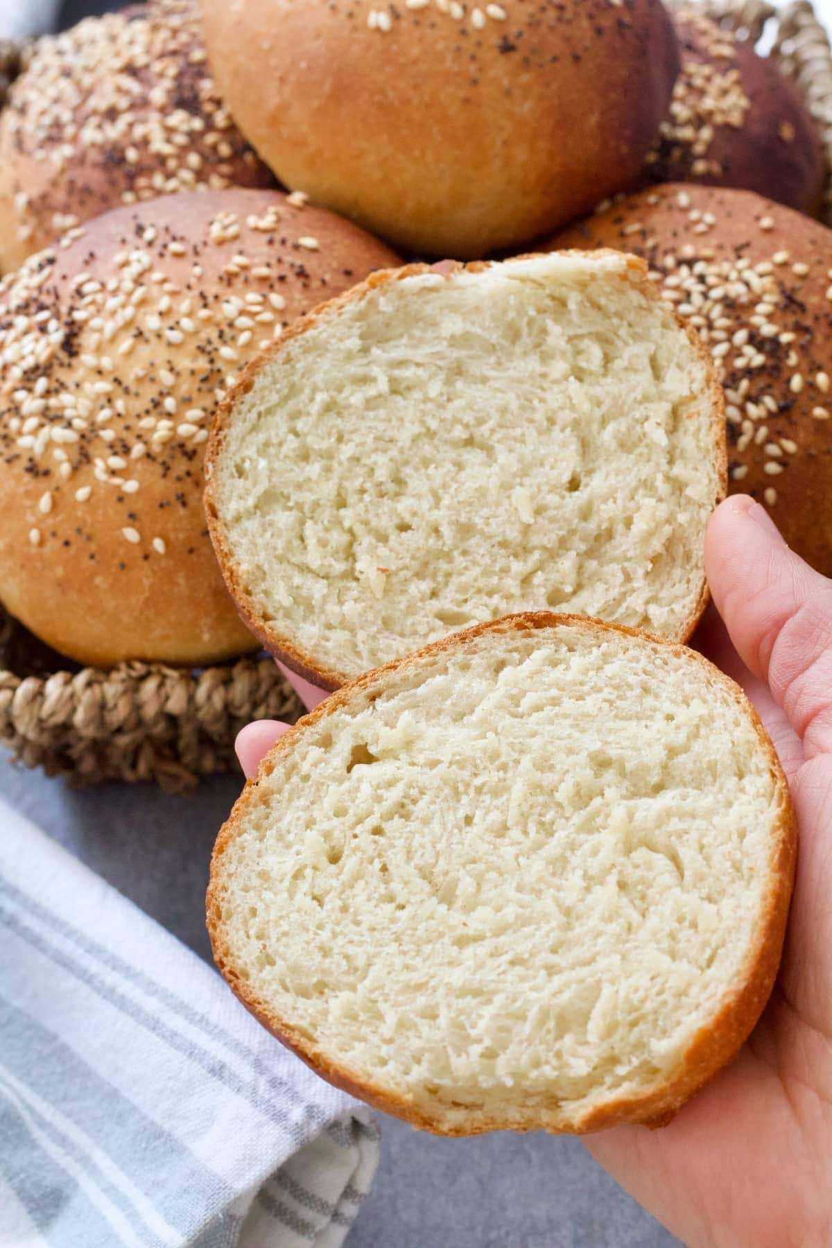 Bread roll cut in half showing the inside crumb.
